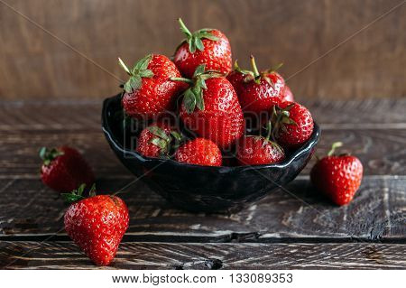 red strawberries strawberries on a brown background strawberries in ceramic ware bowl with strawberries fragrant strawberries ripe strawberries freshly picked strawberries