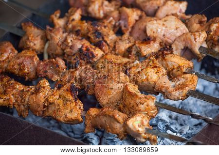 Barbecue , grilled pork meat with spices . Close-up .