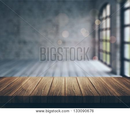 3D render of a wooden table looking into a defocussed empty room with a vintage effect