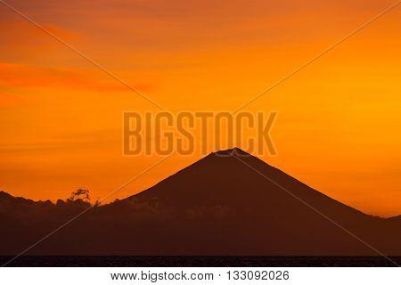 Sunset view on Gunung Batur volcano on Bali from Gili Travangan island, Indonesia