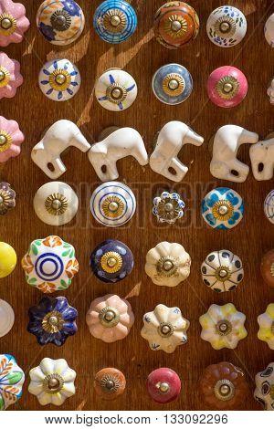 Souvenir doorhandles for sale on Indian market in Jaisalmer, Rajasthan, India.