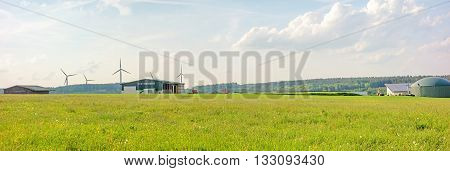 Bartholomae Germany - May 26 2016: Farm with barn and biogas plant green meadow in front