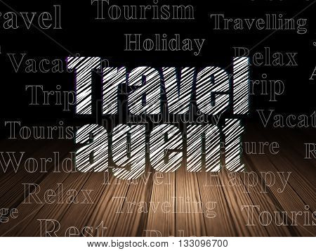 Tourism concept: Glowing text Travel Agent in grunge dark room with Wooden Floor, black background with  Tag Cloud