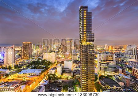 Bangkok, Thailand business district cityscape at night.