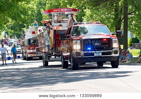 WEST ST. PAUL, MINNESOTA - MAY 21, 2016: Annual West St. Paul Days Grande Parade led by South Metro Fire emergency vehicles driving up Smith Avenue on May 21, 2016.