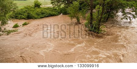 Wild turbulent river flooding the rainy forest