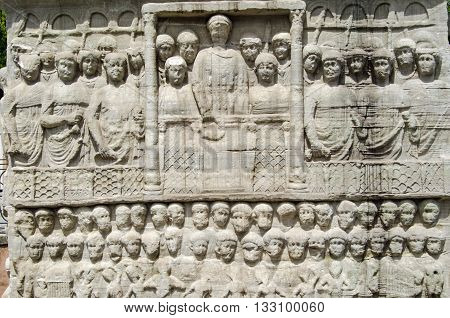 Stone frieze sculpture of the Byzantine Emperor Theodosius showing him in a crowd watching a race at the hippodrome in Istanbul Turkey.