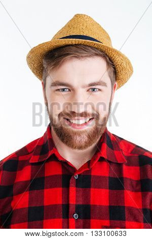 Close-up portrait of a smiling handsome bearded man in a hat isolated on the white background