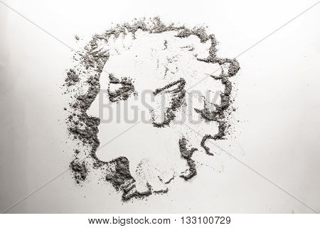 Myth man head drawing in grey ash dust sand dirt