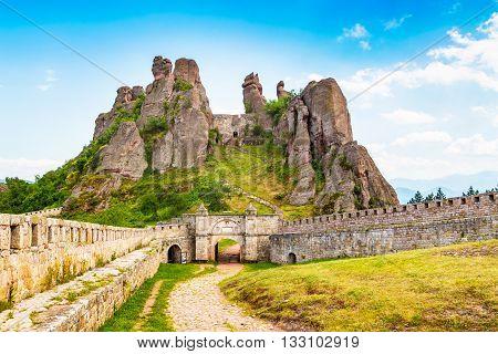Vibrant image of Belogradchik cliff rocks and wall at ancient Kaleto fortress, Bulgaria
