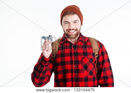 Smiling casual man holding gas lighter and looking at camera