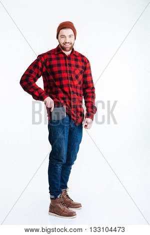 Smiling young handsome guy pulls out tablet pc from his pocket isolated on the white background