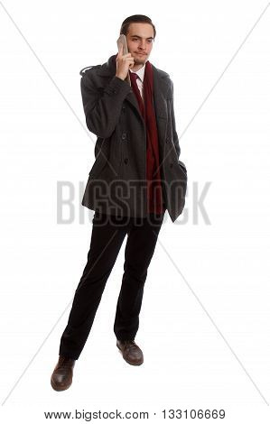 A formal businessman standing and talking on his phone