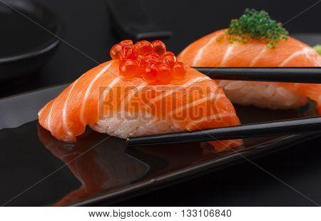 Sushi Nigiri Over Black Background