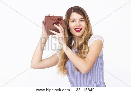 Present. woman in black dress holding gift