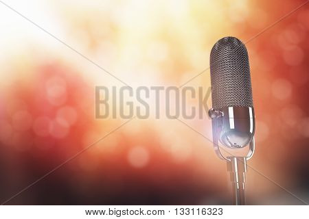 Microphone head on abstract red and yellow background with limelight. 3D Rendering