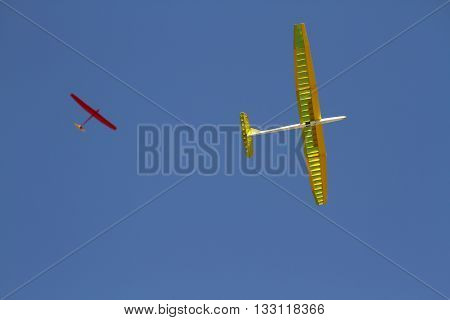 yellow and red  Airplane model against blue sky