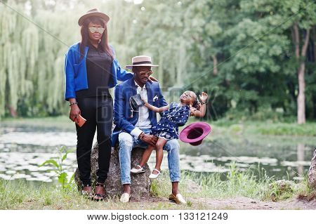 Stylish and rich african american family outdoor