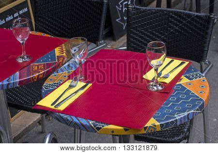 Small table for two on the sidewalk near the cafe. Paris France.