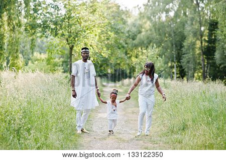 African American Family At White Nigerian National Dress Having Fun Outdoor