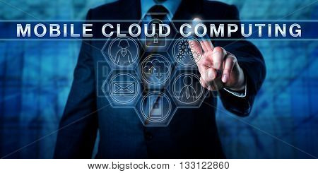 Manager touching MOBILE CLOUD COMPUTING on an interactive virtual control screen. Business metaphor and information technology concept for smartphone convergence with cloud-based computing resources.