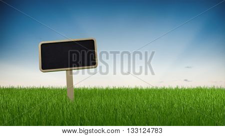 Blank slate signboard on lush green grass against a gradient blue sky with copy space, panoramic banner. 3d Rendering.