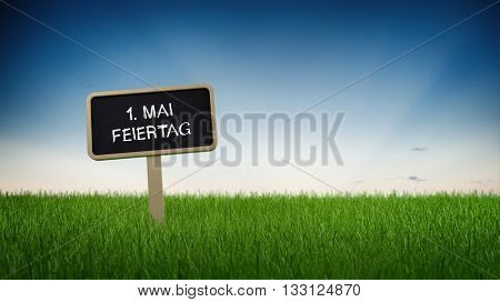 May first holiday text in white chalk on blackboard sign in flowing green grass under clear blue sky background. German Language. 3d Rendering.