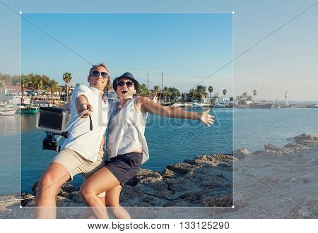 Funny couple take a selfie in the sea bay