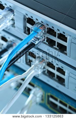 Ethernet cables connected to network switch, close up