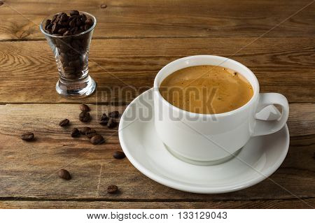 Coffee cup and coffee beans on rustic background. Cup of coffee. Strong coffee. Morning coffee. Coffee break. Coffee mug. Coffee cup.
