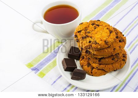Homemade cookies chocolate and cup of tea. Homemade cookies. Tea time. Sweet dessert. Homemade biscuit. Breakfast cookies. Tea cup.