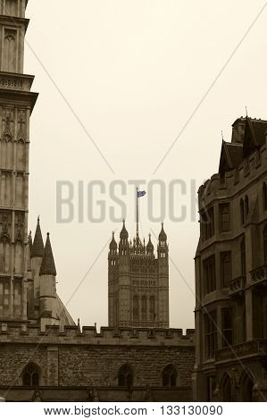 LONDON, UK - NOVEMBER 27: The British flag flies on a side tower with battlements the Victoria Tower of Westminster Palace on November 27, 2014 in London.