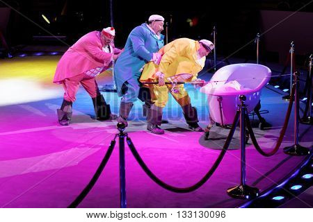ST. PETERSBURG, RUSSIA - JUNE 2, 2016: Clown group Three Fat Men in the dress rehearsal of the Show of Water, Fire, And Light in the Ciniselli circus. This new show 1st time arrived in St. Petersburg