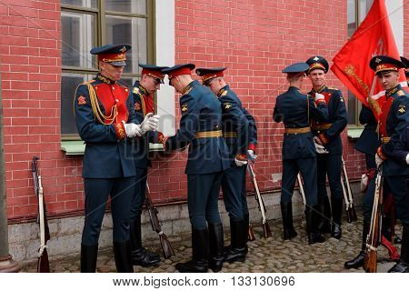 ST. PETERSBURG, RUSSIA - MAY 28, 2016: Honor guardians prepare to the ceremony in St. Peter and Paul fortress. The ceremony was held since the foundation of fortress till 1926, and then since 2008