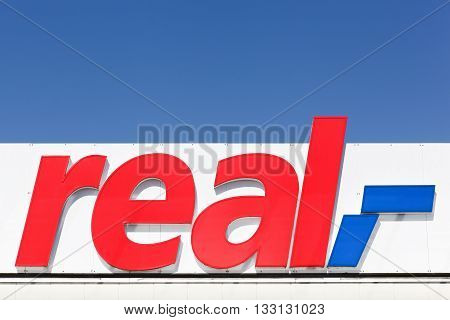Flensburg, Germany - June 4, 2016:  Real sign on a facade. Real is a European hypermarket, member of the German trade and retail giant Metro AG