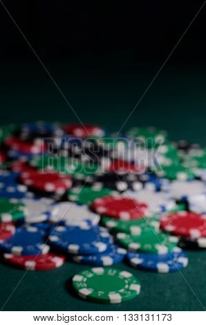 Blurred Chips stack on a green background.