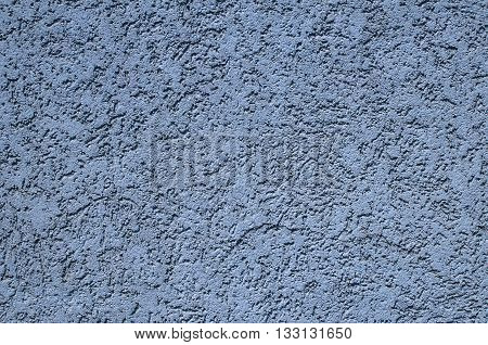 Blue painted plastered facade house wall as background