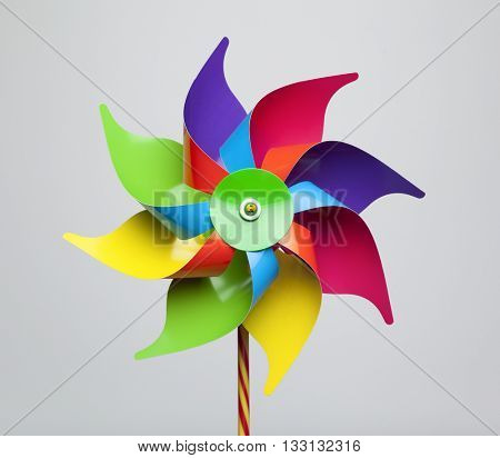 Colorful pinwheel isolated on grey background