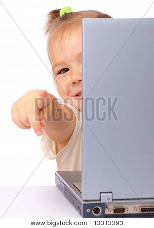 Cute Little Girl Is Looking Out From Her Laptop