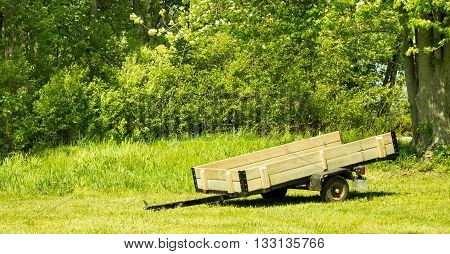 Empty trailer waiting idle in a field