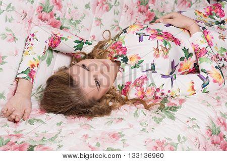 Sensuality young woman lying on sofa. Boudoir type shooting.