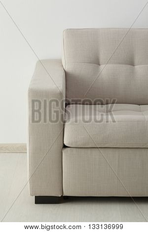 White sofa isolated against the white wall