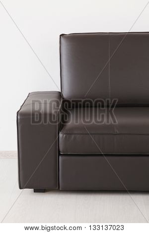 Brown Leather Sofa Against The Wall