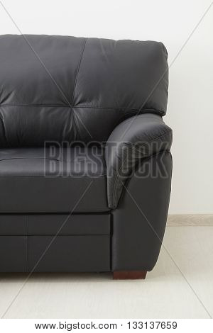 Black Brown Leather Sofa Against The Wall