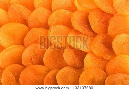 Dried apricots background. Dried apricots in closeup.