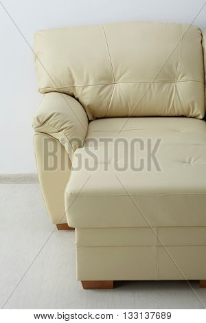 White Leather Sofa Against The Wall
