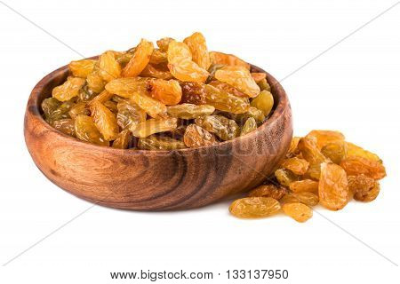 Raisins in a wooden cup on white background. Closeup.