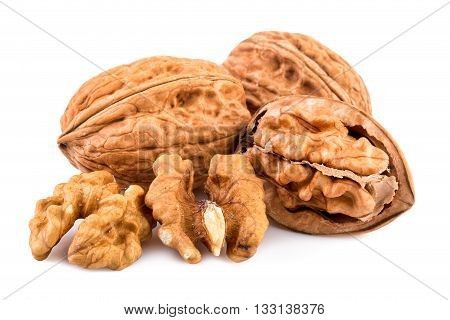 Walnuts and shelled walnuts on white background. Close-up.