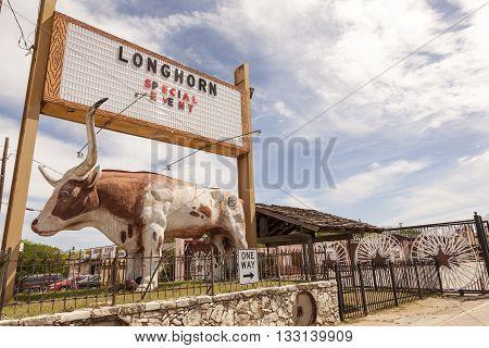 DALLAS USA - APR 8: Longhorn steak restaurant with a bull statue in Dallas. April 8 2016 in Dallas Texas United States