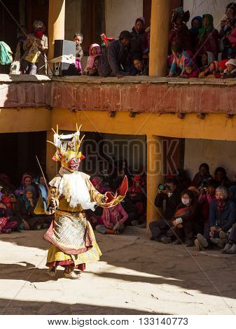 Korzok, India - July 23, 2012: unidentified monk in deer mask with sword performs religious mystery dance of Tibetan Buddhism during the Cham Dance Festival in Korzok monastery, India.